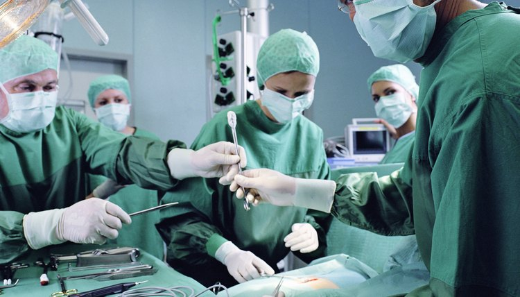 Group of surgeons working in operating theatre