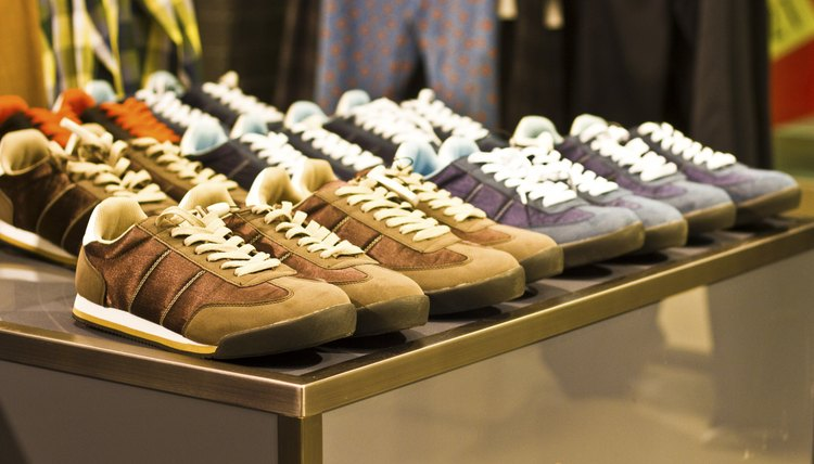 Mens athletic shoes on display in a clothing boutique.