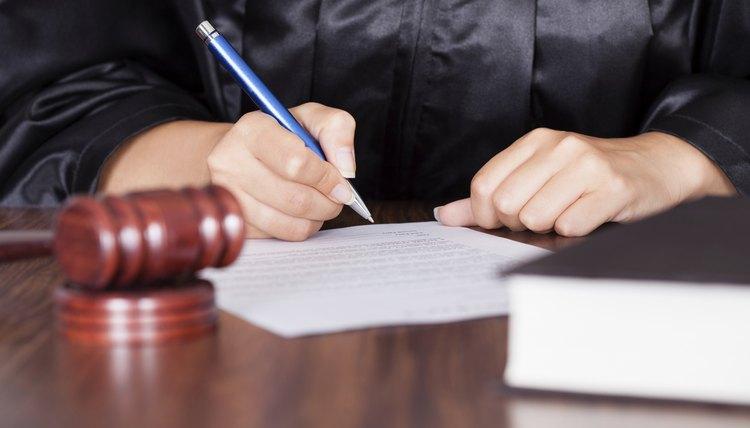 Female Judge Writing On Paper