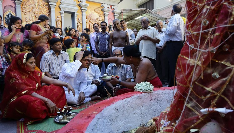 A priest performs a puja service in March 2013.