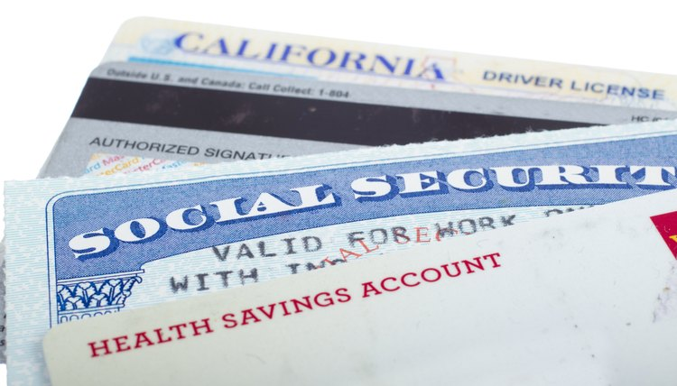 Close-up of a Social Security card, driver's license, and other forms of ID