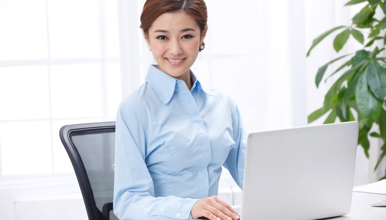 Young business lady using laptop