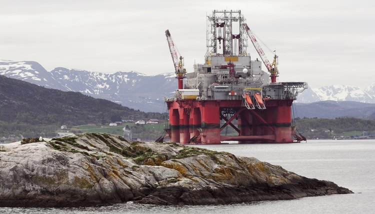 Oil rig in fjord landscape