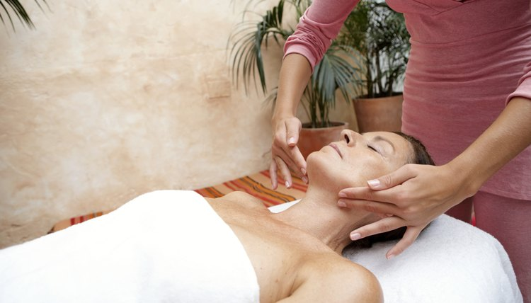 Mature woman receiving massage, eyes closed