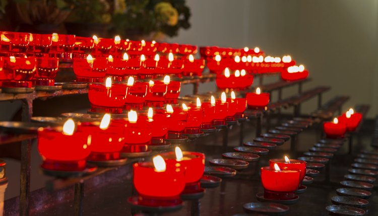 Close-up of red candle set-up in church.