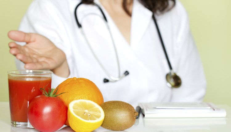 Doctor nutritionist in office with healthy fruits