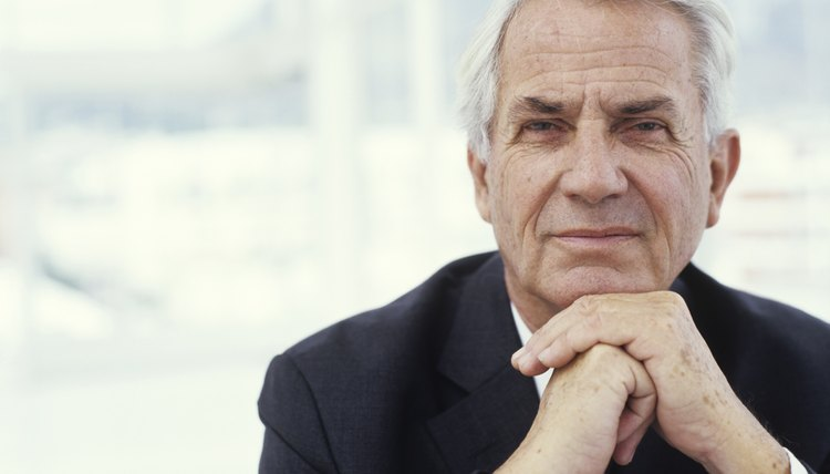Businessman with hands on chin, close up, portrait