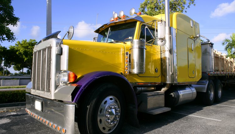 yellow american truck with stainelss steel