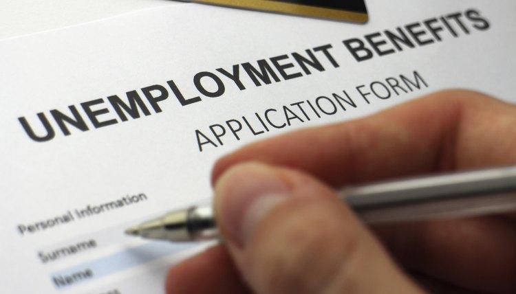 Man filling out unemployment benefit application form