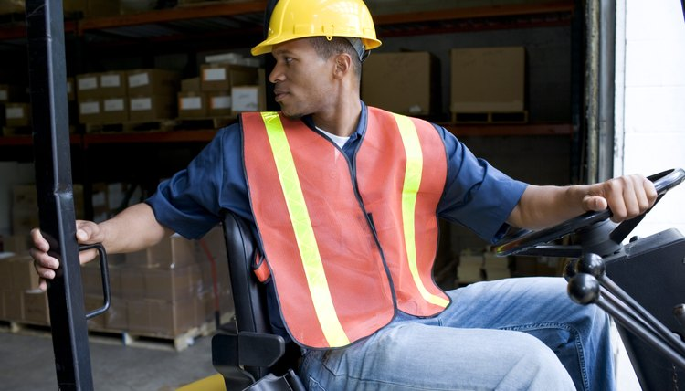 Man operating forklift