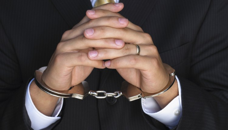 Hands of businessman in handcuffs
