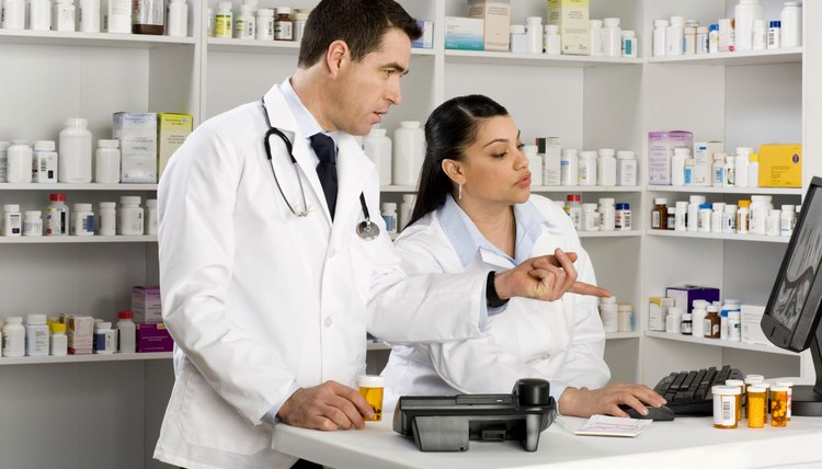 Doctor and pharmacist at computer