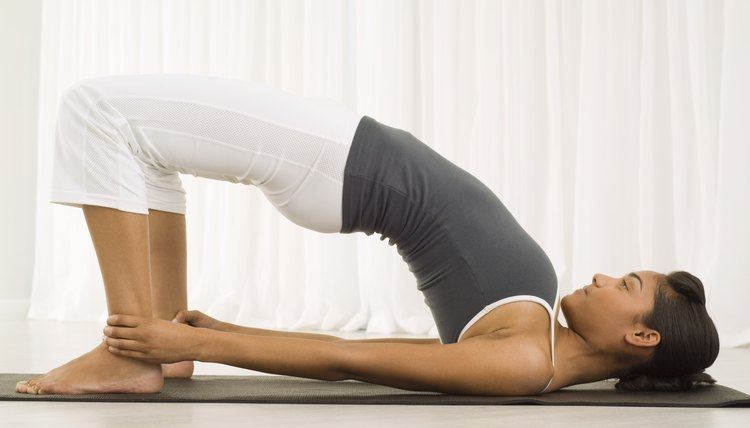 Bridge pose strengthens lower back and core muscles.