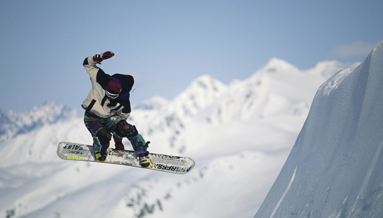 Snowboarder in air, Chugach Mountains, Alaska, USA