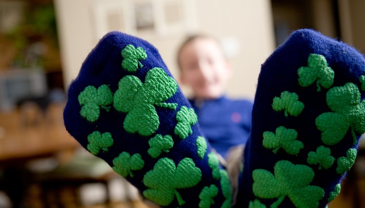 Child wearing Irish socks with three leaf clovers
