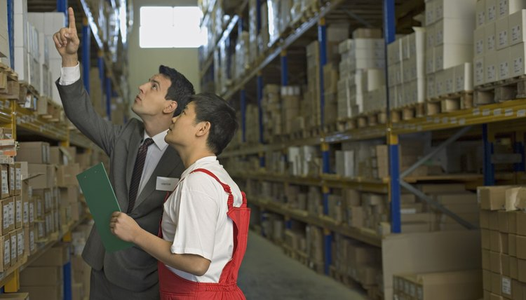 Worker and businessman looking at boxes