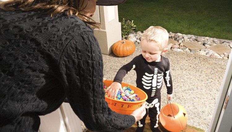 Giving out Halloween candy became the trend in the 1950s.