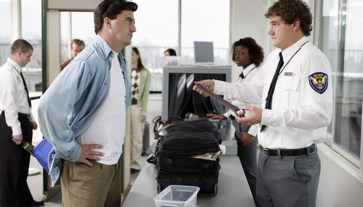 security guard and man at airport - Transportation Security Officer