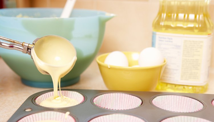 Pouring batter into muffin tin