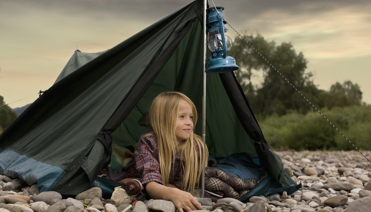 Girl scout looking out of tent