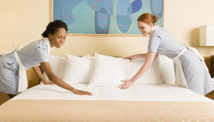 maids making bed - Housekeeping Responsibilities