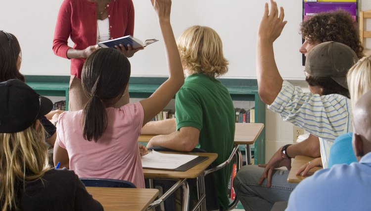 Teacher interacting with students in classroom.