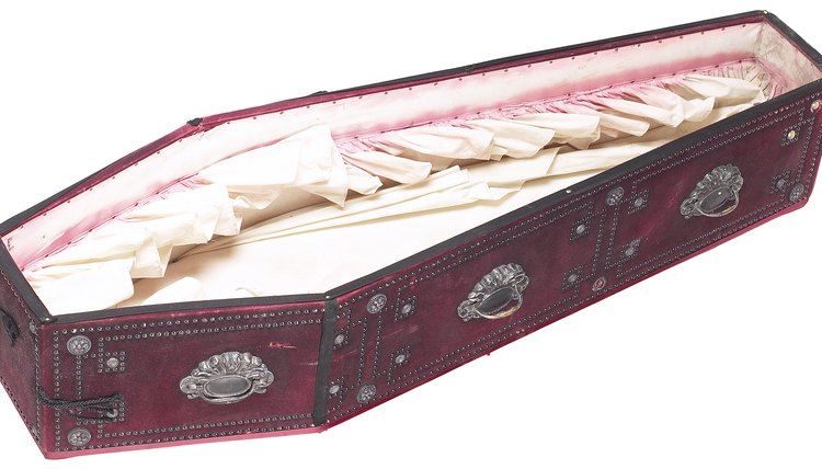 The vigil often includes an open casket and embalmed corpse.