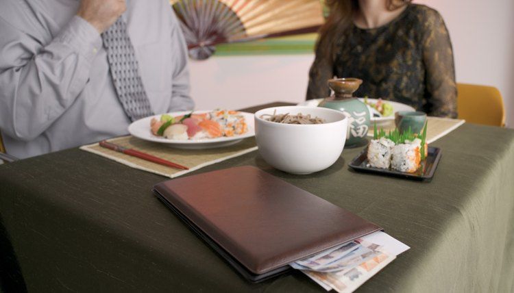 Avoid the awkward moment when the check is resting on the edge of the table.
