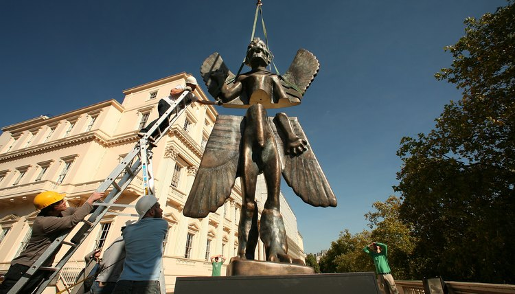 A sculpture of the Mesopotamian god, Pazuzu, on display outside of an art museum in London.