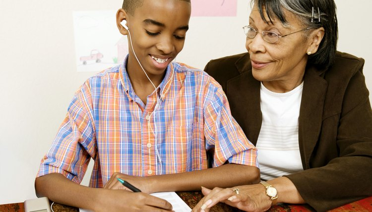 Grandmother helping boy with homework