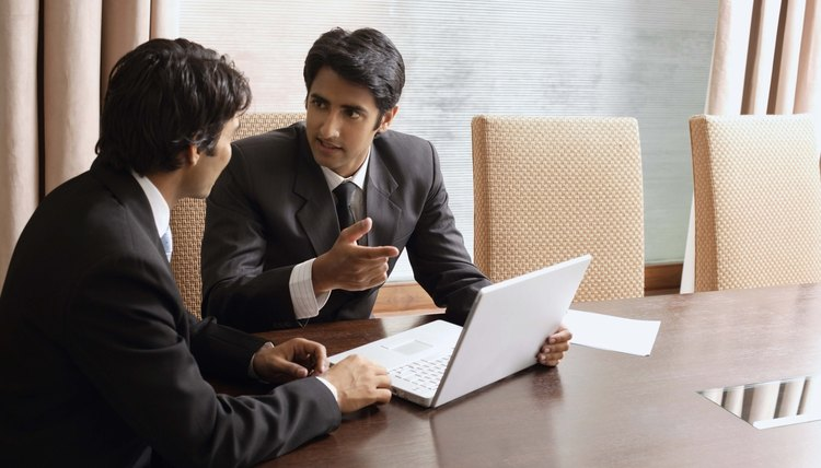 Businessmen with laptop computer