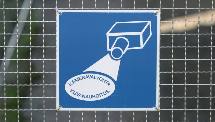 Surveillance sign on fence