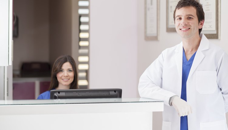 Dentist and receptionist greeting patients