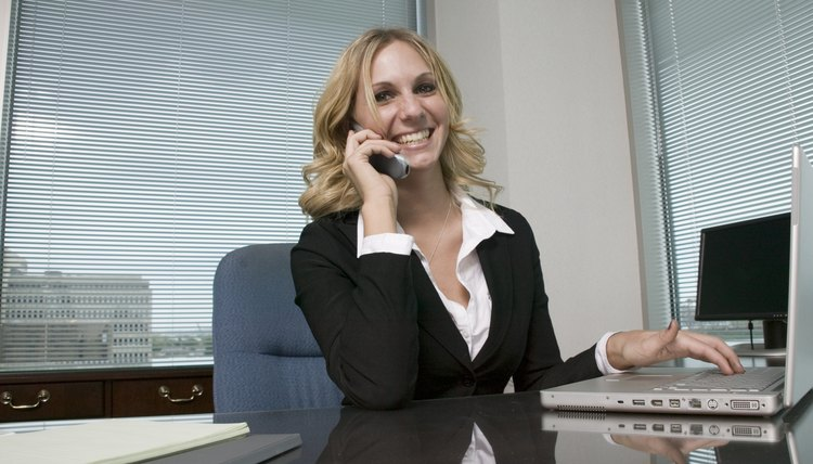 Woman at desk on phone