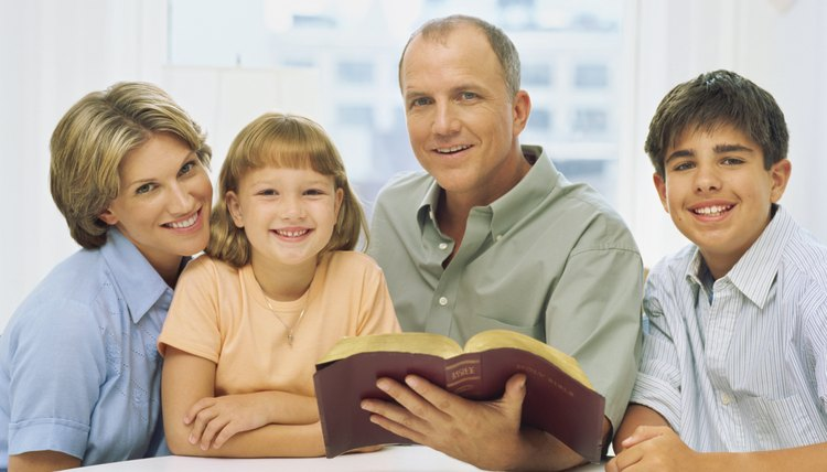 Kids are with their parents learning about the Bible.