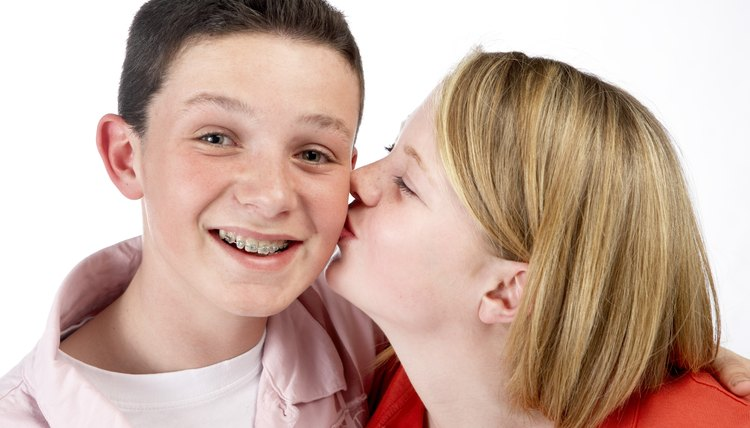 A playful kiss on the cheek can express appreciation and affection.