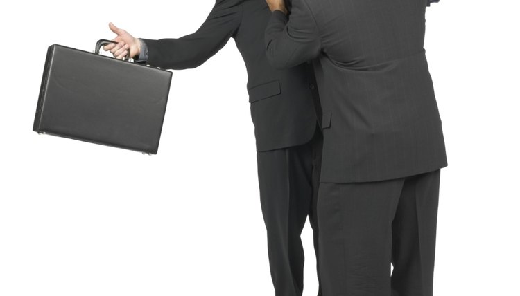 Two Businessmen In Suits Having A Disagreement