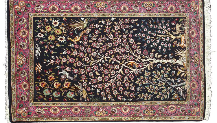 A Mughal Carpet With Naturalistic Vegetal Patterns And Mille Fleur Design
