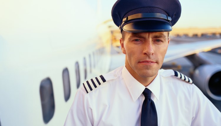 Portrait of Pilot in Front of Cargo Plane