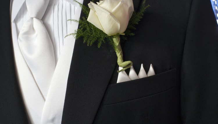 Male members of the wedding party are given boutonnieres to wear.