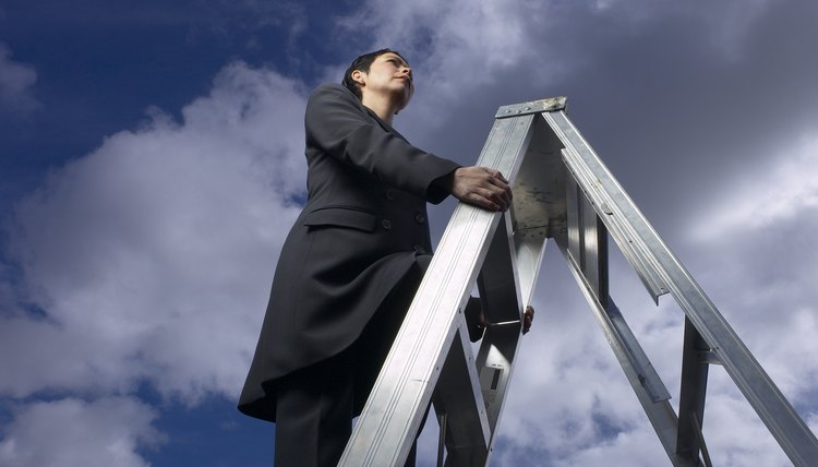 Businesswoman climbing corporate ladder