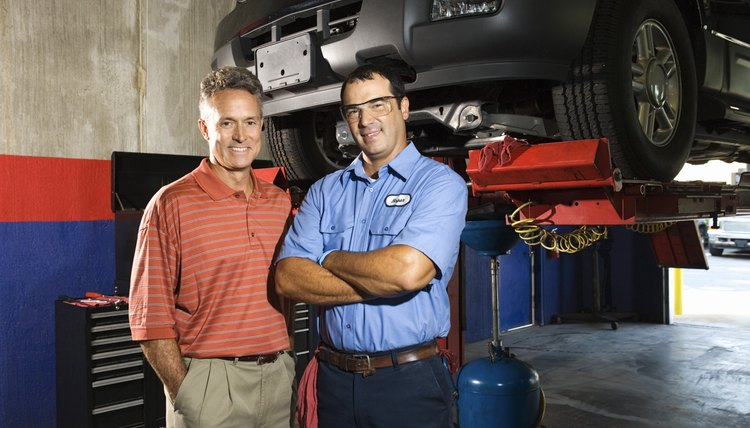 Auto mechanic and supervisor in repair shop