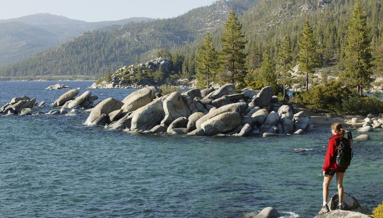 Woman hiking along the shore of Lake Tahoe