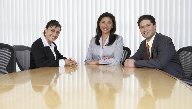 Three business professionals sitting at table