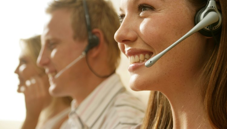 Smiling woman wearing telephone headset