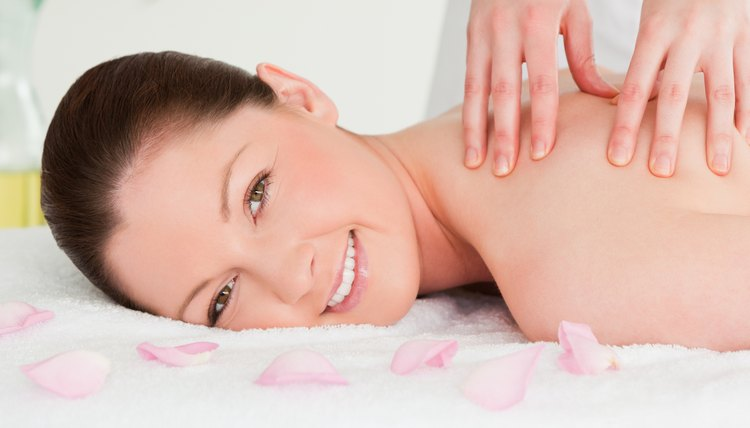 Beautiful woman having a massage while looking at the camera