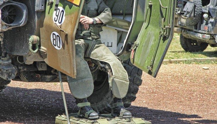 A man exiting a bomb squad vehicle.