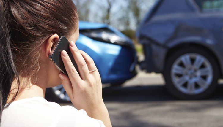 Woman Making Phone Call After Traffic Accident