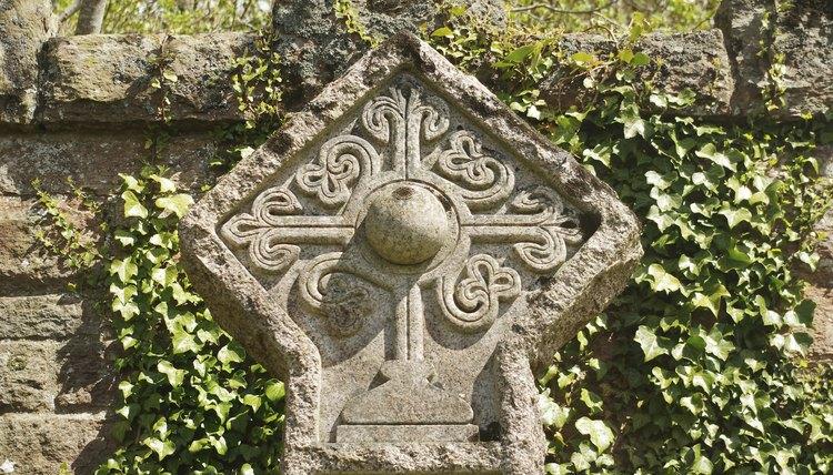 A Rosicrucian cross stone carving in a cemetery in Roslin, Scotland.