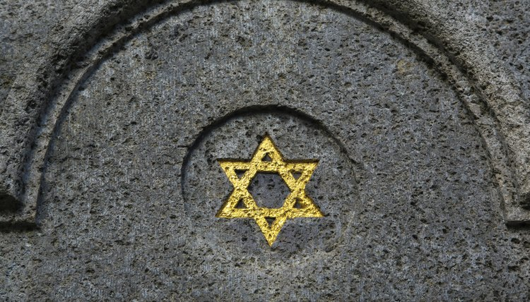 A gold star of David on a tombstone